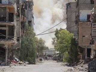 Hunger and bombs plague life in Daraya