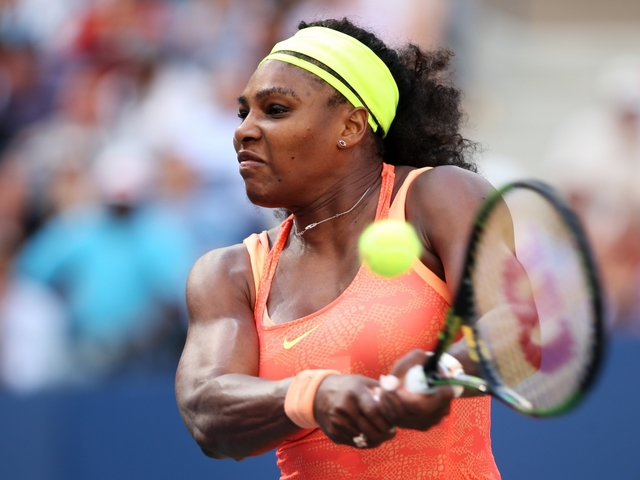 Serena Williams overcomes shoulder injury to reach round two at Flushing Meadows