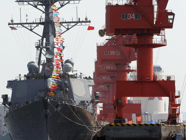 US Navy destroyer collides with merchant vessel off Japan