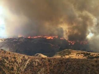 Western US facing scorcher days, massive fires