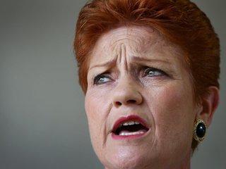Australian official wears burqa, wants it banned