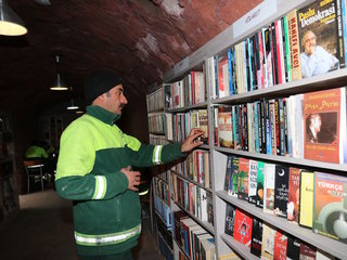 Trash collectors open library with tossed books