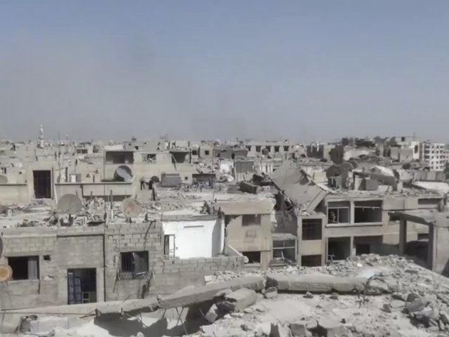 Gas attack reported on Syrian rebel enclave, Damascus denies