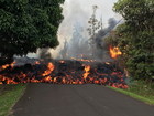 Watch: Lava from volcano moves down road