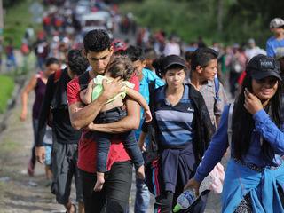 Thousands in caravan waiting to cross border